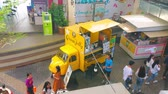 tribunal : BANGKOK, THAILAND - APRIL 22, 2019: The yellow coffee shop on the wheels parked in the pedestrian alley of Tha Maharaj pier, on April 22 in Bangkok
