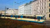 dekor : VIENNA, AUSTRIA - FEBRUARY 18, 2019: The vintage blue-white tram rides along the Resselpark and crosses busy avenue, lined with classical edifices, on February 18 in Vienna.