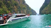 alpen : PHIPHI LEH, THAILAND - APRIL 27, 2019: The tourists enjoy swimming and snorkeling in waters of emerald Pileh Bay lagoon of Phi Phi Leh Island, lined with limestone cliffs, on April 27 in PhiPhi Leh