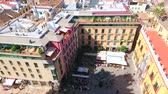 alpen : MALAGA, SPAIN - SEPTEMBER 26, 2019: Panorama of Plaza del Obispo square with outdoor cafes, restaurants, Palacio Episcopal (Bishops Palace) and city roofs, on September 26 in Malaga