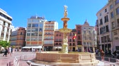 medievale : MALAGA, SPAIN - SEPTEMBER 26, 2019: The carved Genoa Fountain, decorated with marble sculptures and reliefs in Plaza de la Constitucion (Constitution Square), on September 26 in Malaga