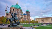 vecht : BERLIN, GERMANY - OCTOBER 3, 2019: The view from the balustrade of Old Museum on bronze sculpture of the Lion Fighter, people in Lustgarten Park and huge Cathedral, on October 3 in Berlin