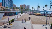 quai : MALAGA, SPAIN - SEPTEMBER 28, 2019: Muelle Uno seaside promenade with line of fashion stores, cafes, restaurants, tourist ferry terminal and yacht port, on September 28 in Malaga