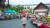 messe : CHIANG MAI, THAILAND - MAY 4, 2019: The stalls in tents of Saturday Night Market in Wualai walking street with handmade toys, souvenirs, jewelries and accessories, on May 4 in Chiang Mai