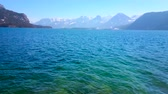 ondulation : Watch the bright blue rippled surface of  Wolfgangsee lake and Alps of Salzkammergut, surrounding it, St Gilgen, Austria