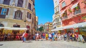 menschenmenge : MALAGA, SPAIN - SEPTEMBER 26, 2019: The crowded noisy Plaza Carbon (square), lined with outdoor cafes, cozy bars and stores, located in historical edifices, on September 26 in Malaga