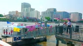 quai : BANGKOK, THAILAND - APRIL 22, 2019: The large group of tourists gets off the ferry, arrived to the pier on Chao Phraya river, on April 22 in Bangkok