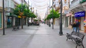 eski moda : SANLUCAR, SPAIN - SEPTEMBER 22, 2019: Calle Ancha is main shopping promenade, lined with bars, restaurants, fashion boutiques and souvenir shops, located in old edifices, on September 22 in Sanlucar