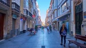 barok : CADIZ, SPAIN - SEPTEMBER 19, 2019: Walk through historic Calle Ancha street, lined with splendid Baroque and Art Nouveau mansions and edifices, fashion stores, fine cafes, on September 19 in Cadiz Wideo