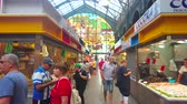 vyrobit : MALAGA, SPAIN - SEPTEMBER 28, 2019: Interior of fresh fish section of Atarazanas central market, lined with stalls and decorated with large arched stained-glass window, on September 28 in Malaga