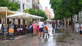 slunečník : JEREZ, SPAIN - SEPTEMBER 20, 2019:  Old town is full of cozy cafes, wine houses, tourist restaurants and fast foods, many of which are located in Calle Lanceria streets, on September 20 in Jerez
