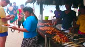 relaxace : PHUKET, THAILAND - MAY 1, 2019: The open air kitchen of small beach cafe of Khai Nok island, cooks prepare chicken, fish, lobsters, shrimps and squids on grill, on May 1 on Phuket