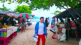 chata : PHUKET, THAILAND - MAY 1, 2019: The food court of Khai Nok island with many stalls, outdoor cafes and bars, on May 1 on Phuket Dostupné videozáznamy