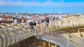 espagne : SEVILLE, SPAIN - OCTOBER 1, 2019: People enjoy the cityscape with town roofs from the panoramic terrace of Metropol Parasol, observing white Barqueta and Alamillo bridges, on October 1 in Seville