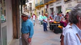 menschenmenge : JEREZ, SPAIN - SEPTEMBER 20, 2019: The crowded Calle Levante - narrow shopping street, lined with historical edifices, located in old town, on September 20 in Jerez