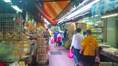 vyrobit : BANGKOK, THAILAND - APRIL 15, 2019: The produce Sampheng market with different Chinese and Thai foods - peking duck, dry seafood and fish, spices, rice noodles and oolong tea, on April 15 in Bangkok