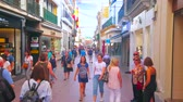 eski moda : SEVILLE, SPAIN - OCTOBER 1, 2019: Vibrant life in Calle Sierpes pedestrian shopping street, located in Old Town and popular for large amount of different stores and boutiques, on October 1 in Seville