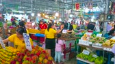 vyrobit : BANGKOK, THAILAND - MAY 13, 2019: Heaps of fresh fruits (rambutan, mango, mangosteen, green bananas, pomelo, papaya, mandarin) in produce section of Talad Saphan Phut market, on May 13 in Bangkok