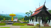 bo : CHIANG MAI, THAILAND - MAY 7, 2019: Panorama of Royal Rajapruek Park with golden tree sculpture, surrounded by white Singha lions, Sala pavilions and colorful flower beds, on May 7 in Chiang Mai