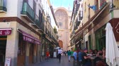 nevada : GRANADA, SPAIN - SEPTEMBER 27, 2019: The crowded narrow Cathedral Marques de Gerona street with cafes, restaurants, souvenir stores and portal of Cathedral on background, on September 27 in Granada