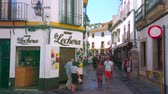 snackbar : CORDOBA, SPAIN - SEPTEMBER 30, 2019: The narrow streets of the old tourist market with many souvenir stores, cafes, bars, art galleries, located next to Mezquita-Catedral, on September 30 in Cordoba