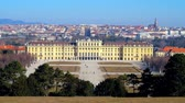 barok : VIENNA, AUSTRIA - FEBRUARY 19, 2019: The scenic skyline from the top of  Schonbrunn hill, observing lush greenery of Great Parterre garden and palace at the hills foot, on February 19 in Vienna