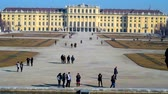 barok : VIENNA, AUSTRIA - FEBRUARY 19, 2019:  The tourists walk the alleys of Grand Parterre ornamental garden of Schonbrunn palace, on February 19 in Vienna.