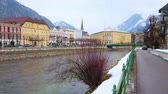 gyalogút : BAD ISCHL, AUSTRIA - FEBRUARY 20, 2019: Riverside walks are perfect time spending in Alpine resort, famous for its beauty among the tourists of Salzkammergut, on February 20 in Bad Ischl Stock mozgókép