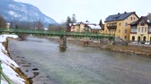 도시 : The winter riverside cityscape of Bad Ischl with Taubersteg pedestrian bridge across the Traun river and historic edifices on embankment, Salzkammergut, Austria