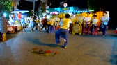 도시 : CHIANG MAI, THAILAND - MAY 4, 2019: Watch fast and rhythmic warrior dance with swords, performed by young artist and drums band at Saturday Night Market, Wualai walking street, on May 4 in Chiang Mai