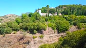 sierra : Panorama of Generalife gardens of Alhambra, occupying the Cerro del Sol (Hill of Sun) and the medieval white housing of historical Sacromonte and Albaicin districts of Granada on background, Spain