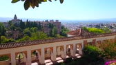 klenba : GRANADA, SPAIN - SEPTEMBER 25, 2019: Panorama of the Patio of Irrigation Ditch and Generalife gardens with Alhambra fortress on SAbika hill on the background, on September 25 in Granada