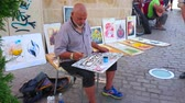 pero : CORDOBA, SPAIN - SEPTEMBER 30, 2019: The artisan creates inscription with black ink and qalam reed pen in technique of Arabic calligraphy, on September 30 in Cordoba Dostupné videozáznamy