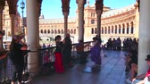 prestazioni : SEVILLE, SPAIN - OCTOBER 1, 2019:Spanish dancer performs emotional flamenco with elements of tap dance in accompaniment of the music band in gallery of Plaza de Espana, October 1 in Seville