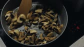 steamed : Close up of delicious sliced ​​button mushrooms being fried with onion on the pan Stock Footage