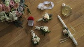 wedding garter : Wedding details. Wedding rings in box, bouquet, candle, perfume and garter lies on a wooden floor
