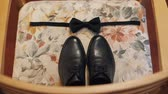 wedding garter : Wedding details. Grooms wedding shoes and tie on a chair