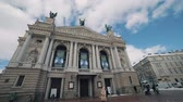 Рим : People are walking along the street near Lviv Opera and Ballet Theater.