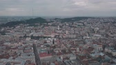 guildhall : Aerial Old City Lviv, Ukraine. Central part of old city. European City. Densely populated areas of the city. Town hall, Ratush, Opera, Dominican church. Lviv central 4k ultrahd Stock Footage