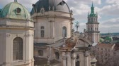 guildhall : Lviv, Ukraine. March 20, 2019: Aerial Roofs and streets Old City Lviv, Ukraine. Dominican Church. Central part of old city. European City. Popular areas. Panorama of the ancient town. Rooftops
