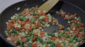 being prepared : Close up of a pan fry meal of delicious asparagus, pepper, corn and carrot for a colorful vegetarian stir fry meal