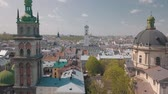 guildhall : Lvov, Ukraine. Aerial Roofs and streets old city Lviv. Central part of old city. European city in spring. Panorama of the ancient town. Town Hall, Council, Ukraine Dominican Church. Drone shot