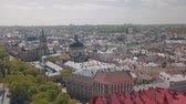 town hall : Lvov, Ukraine. Aerial Roofs and streets old city Lviv. Central part of old city. European city in spring. Panorama of the ancient town. Town Hall, Council, Ukraine Dominican Church. Drone shot