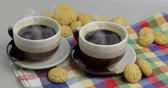 podšálek : Cookie and two cups of coffee. Kruidnoten, pepernoten, traditional sweets, strooigoed