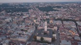 ucraniano : Aerial roofs and streets Old City Lviv, Ukraine. Central part of old european city in morning time. Panorama of the ancient town. City Council, Town Hall, Ratush. Drone shot