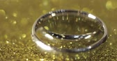 platina : Wedding silver rings lying on shiny glossy surface. Shining with light. Close-up, macro shot Stock Footage