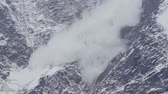 alasca : Avalanche is coming down a glacier in the Caucasus Mountains, Russia