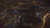 A view of the night city from the airplane window. Moscow. Vídeos