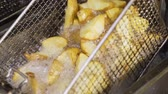 French Fries are Deep Fried, Boiling Oil, Lift Up and Dip Look so Tasty Stock Footage