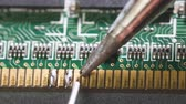 stampati : Close-up shot of electronics repair. Electronics repair soldering microchips